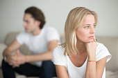 Serious sad woman thinking over a problem, man aside, meeting therapist, poor chance of getting pregnant after 40, unmet expectations, unable to handle family finances, interested in different things