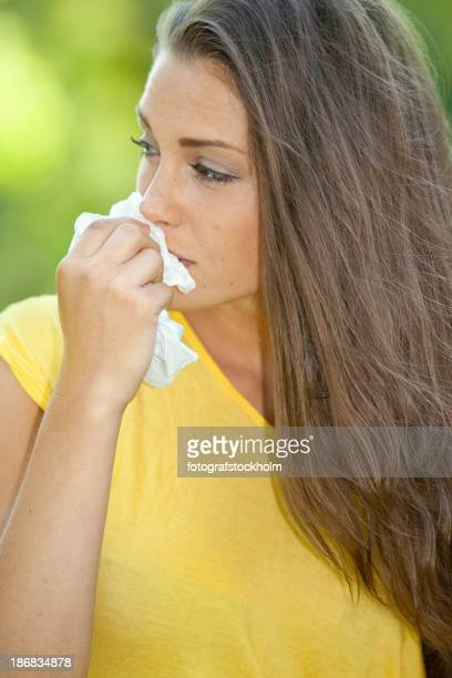Sad woman with hankerchief.