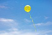 Sad yellow balloon face