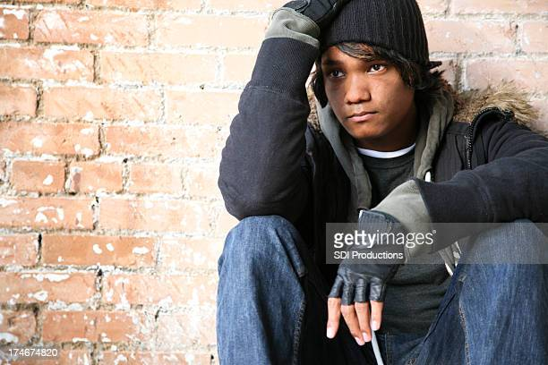 Sad Young Man Sitting and Looking Off To The Distance