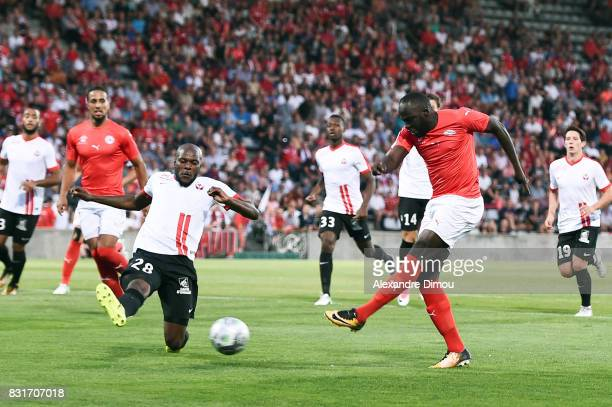 Sada Thioub of Nimes and Julien Cetout of Nancy during the Ligue 2 match between Nimes Olympique and As Nancy Lorraine at Stade des Costieres on...