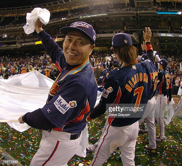 Sadaharu Oh manager of Team Japan takes a victory lap around PETCO Field after Japan defeated Cuba in the Championship Game of the of the 2006 World...