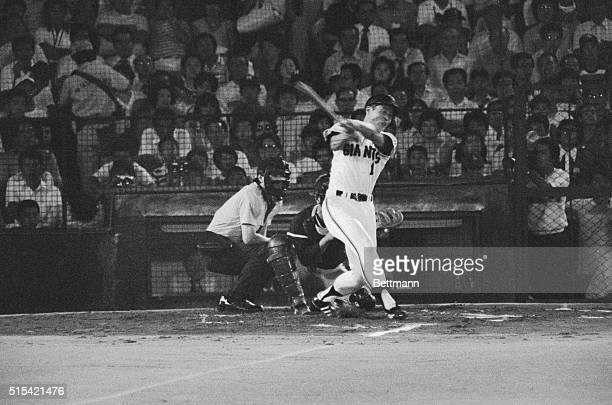 Sadaharu Oh of the Yomiuri Giants is all smiles en route to home plate after hitting his 799th career homer in the first inning of a game against...
