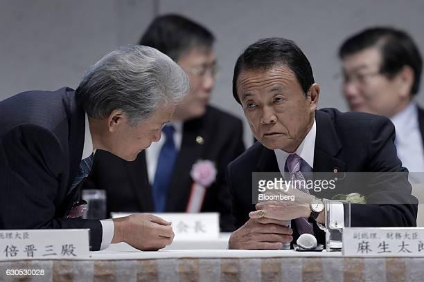 Sadayuki Sakakibara chairman of the business federation Nippon Keidanren left talks to Taro Aso Japan's finance minister as they attend a meeting at...