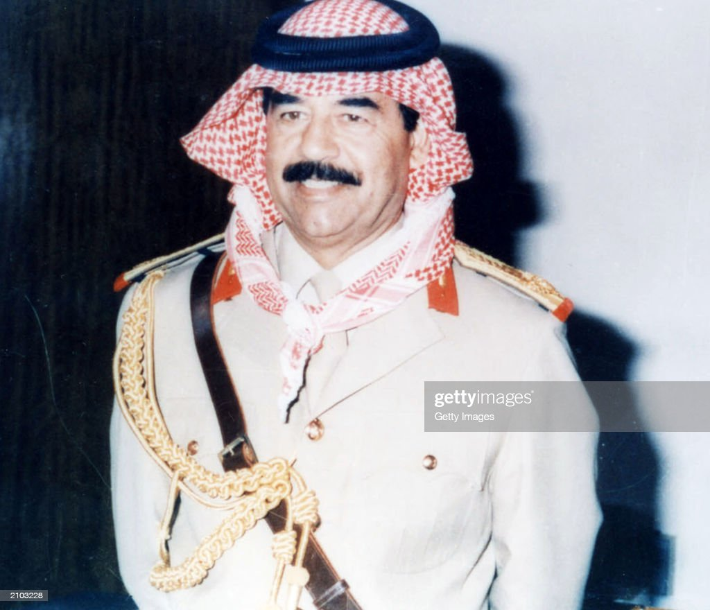 Saddam Hussein poses in an undated photo. Officials say the United States is offering a $25 million reward for any information leading to the capture of ousted Iraqi president Saddam Hussein or proof of his death.