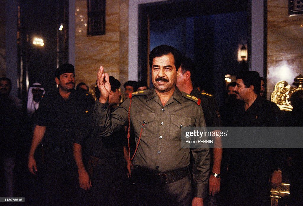 <a gi-track='captionPersonalityLinkClicked' href=/galleries/search?phrase=Saddam+Hussein&family=editorial&specificpeople=121553 ng-click='$event.stopPropagation()'>Saddam Hussein</a> welcomes his people In Baghdad, Iraq On October 17, 1983.