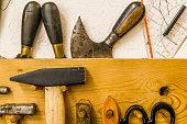 Saddlers tools on tool board