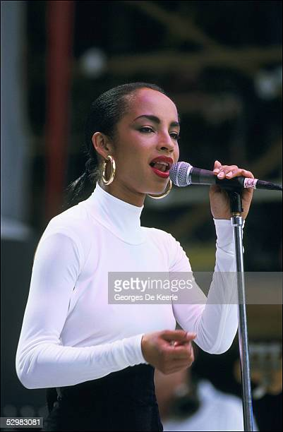 Sade performs on stage during the Live Aid concert at Wembley Stadium on 13 July 1985 in London England Live Aid was watched by millions around the...
