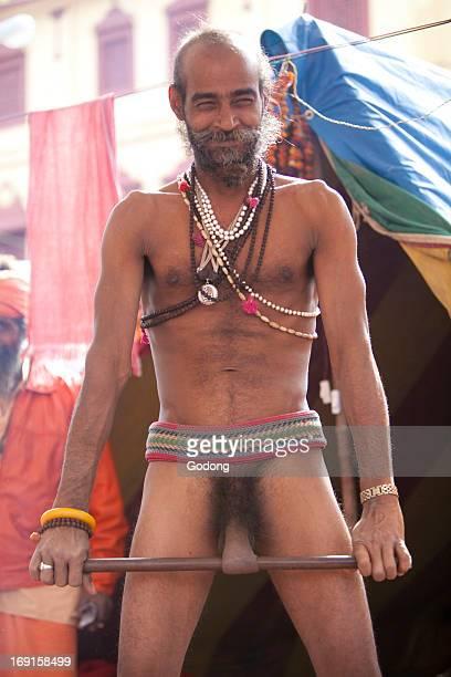 Sadhu at the Kumbh Mela in Haridwar February 2010 Practising a penis exercice to show his spiritual strength