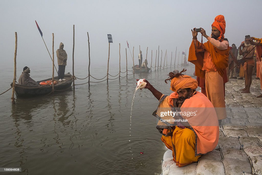 A Sadhu, Hindu holy man, pours water from a conch shell as he prays on the banks of the holy Ganges river ahead of the Maha Kumbh Mela on January 13, 2013 in Allahabad, India. The Maha Kumbh Mela, believed to be the largest religious gathering on earth is held every 12 years on the banks of Sangam, the confluence of the holy rivers Ganga, Yamuna and the mythical Saraswati. The Kumbh Mela alternates between the cities of Nasik, Allahabad, Ujjain and Haridwar every three years. The Maha Kumbh Mela celebrated at the holy site of Sangam in Allahabad, is the largest and holiest, celebrated over 55 days, it is expected to attract over 100 million people.