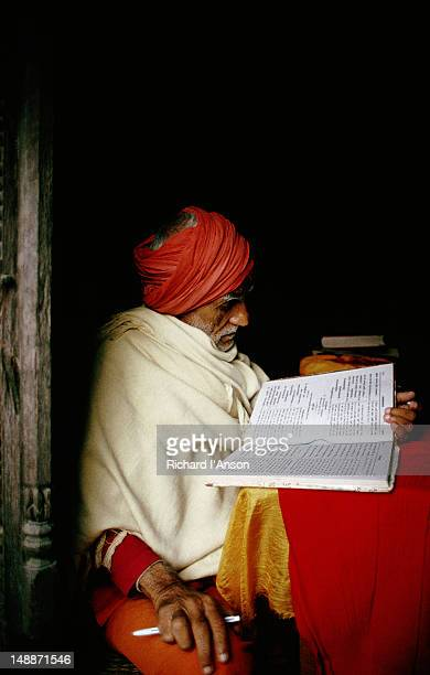 Sadhu, or holy man, studying religious texts at Pashupatinath Temple.