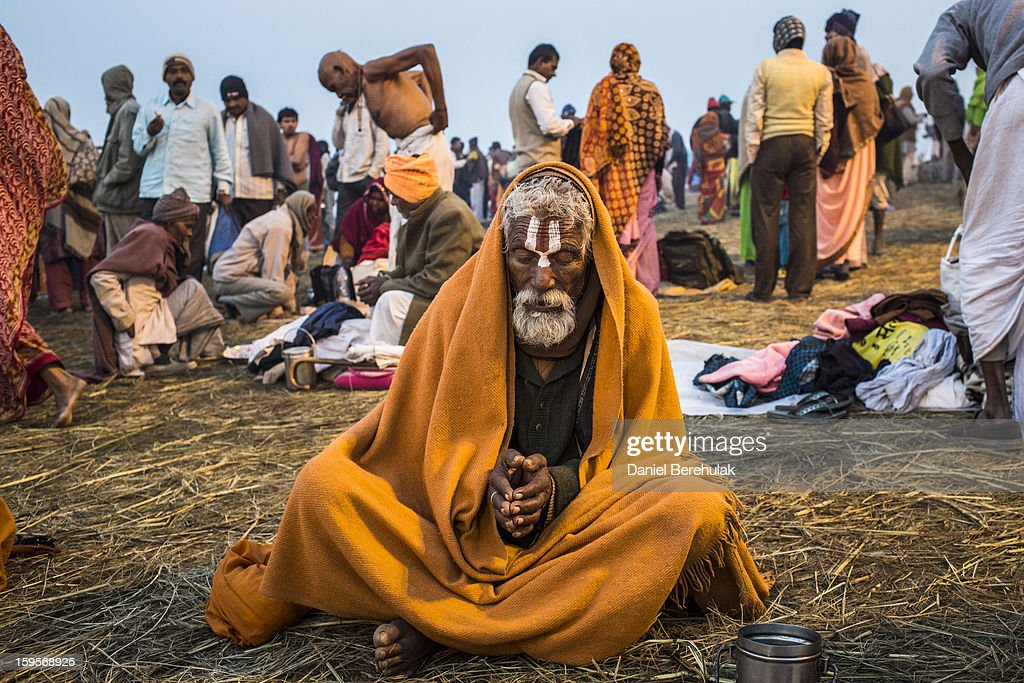 A sadhu prays as he sits on the banks of Sangam, the confluence of the holy rivers Ganges, Yamuna and the mythical Saraswati, during the Maha Kumbh Mela on January 16, 2013 in Allahabad, India. The Maha Kumbh Mela, believed to be the largest religious gathering on earth, is held every 12 years on the banks of Sangam, the confluence of the holy rivers Ganga, Yamuna and the mythical Saraswati. The gathering is celebrated at the holy site of Sangam in Allahabad over 55 days and attracts over 100 million people.