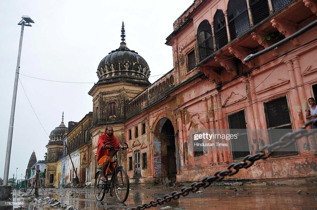 A sadhu rides his bicycle at Ram Ghat Temple on August 27, 2013 in Ayodhya, India.Two days after the failed Parikarma attempt by Vishwa Hindu Parishad (VHP), streets in Ayodhya wears a deserted look with a majority of economical activities limited to certain pockets of the city. Security was on high alert in Ayodhya in wake of Vishwa Hindu Parishad's (VHP) 84 Kosi yatra, which was banned by Uttar Pradesh government.