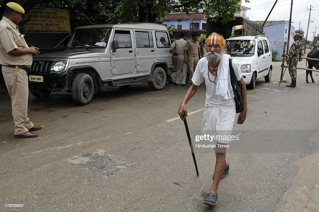 A sadhu walks amidst heavy security on August 28, 2013 in Ayodhya, India. Three days after Vishwa Hindu Parishad (VHP) field Parikarma attempt, Ayodhya saw a heavy presence of security personnel amid Janmashtmi celebrations. old man