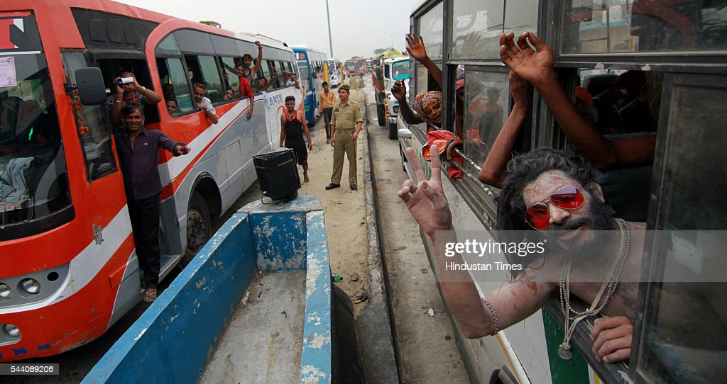 Sadhu's and devotees chant religious slogans as the first batch of Amarnath pilgrims prepares to leave for Amarnath Yatra, an annual Hindu pilgrimage to the Amarnath shrine, on July 1, 2016 in Jammu, India. Thousands of Hindu pilgrims begin an annual pilgrimage on 01 July to the shrine, an icy stalagmite in a mountain cave 4,115 meters (13,500 feet high) above sea level. Hindus worship the stalagmite as an incarnation of the Lord Shiva, the Hindu god of destruction and regeneration.