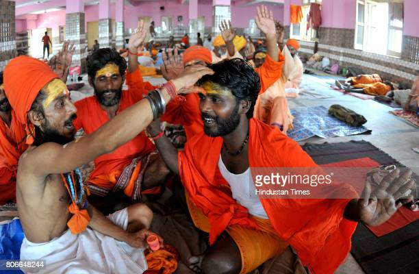 Sadhus or Hindu holy man shouting religious slogans as they waits to register for the annual Amarnath pilgrimage at Amarnath Yatra base camp on July...