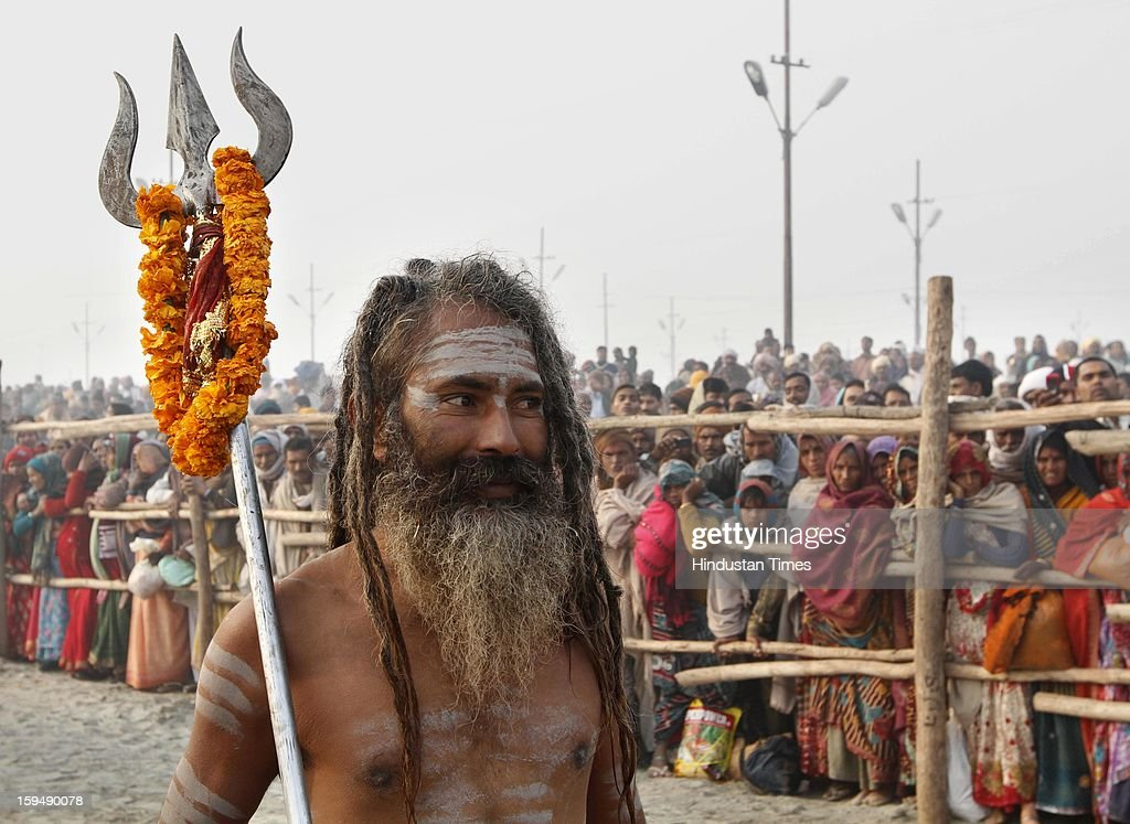Sadhus take Shahi Snan (royal bath) at the bank of Sangam confluence of river Ganga, Yamnuna and mythical Saraswati on the occasion of Makar Sankranti on January 14, 2013 in Allahabad, India. Kumbh is World's biggest religious gathering, in which more that 100 million of Hindus and sikh devotees will take part over next 55 days. Apart from being pilgrimage of faith, salvation and hope for millions of devotees, it also serve as meeting ground for the vast spectrum of Indian religious and spiritual views.
