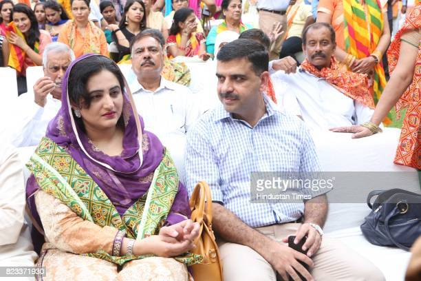 Sadia and Amir Ajmal during the Teej festival celebrations organised at the residence of Smriti Irani on July 25 2017 in New Delhi India The guests...