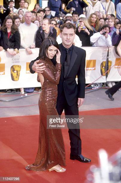 Sadie Frost and Jude Law during BAFTA Awards 2000 Arrivals at Leicester Square in London Great Britain