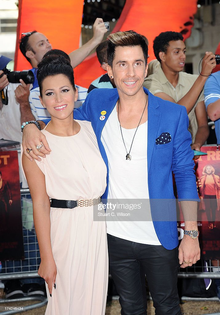 Sadie Hasler and <a gi-track='captionPersonalityLinkClicked' href=/galleries/search?phrase=Russell+Kane&family=editorial&specificpeople=6213345 ng-click='$event.stopPropagation()'>Russell Kane</a> attends the European Premiere of 'Red 2' at Empire Leicester Square on July 22, 2013 in London, England.