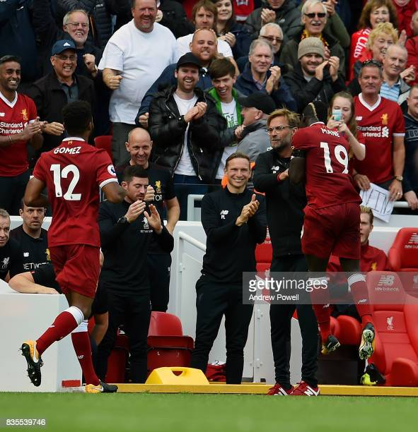 Sadio Mane celebrates with Jurgen KLopp manager of Liverpool during the Premier League match between Liverpool and Crystal Palace at Anfield on...