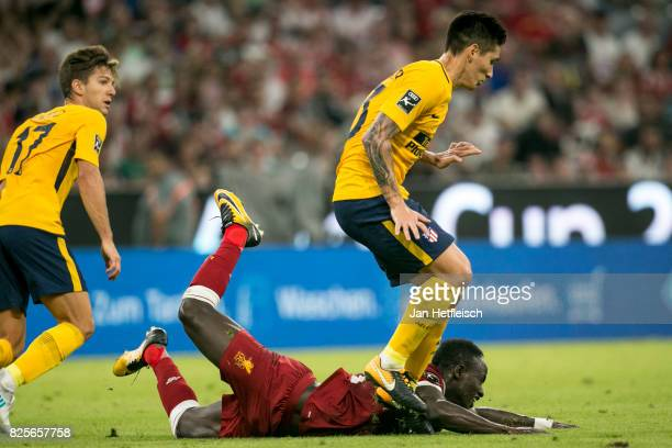 Sadio Mane of FC Liverpool and Kranevitter of Atletico Madrid fight for the ball during the Audi Cup 2017 match between Liverpool FC and Atletico...