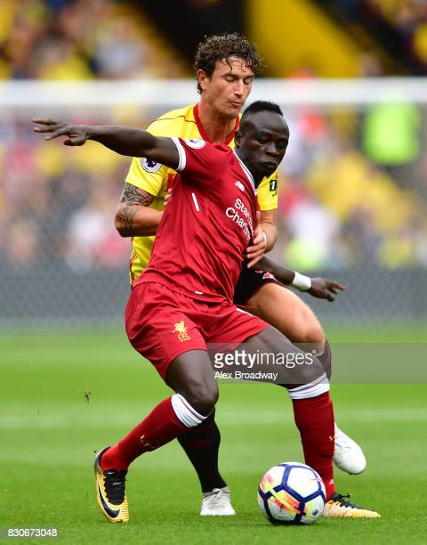 Sadio Mane of Liverpool and Daryl Janmaat of Watford battle for possession during the Premier League match between Watford and Liverpool at Vicarage...