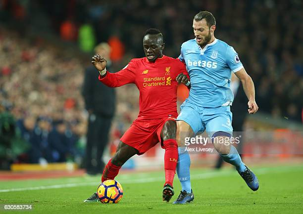 Sadio Mane of Liverpool and Erik Pieters of Stoke City battle for the ball during the Premier League match between Liverpool and Stoke City at...