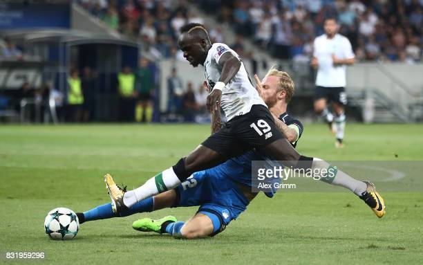 Sadio Mane of Liverpool and Kevin Vogt of Hoffenheim during the UEFA Champions League Qualifying PlayOffs Round First Leg match between 1899...