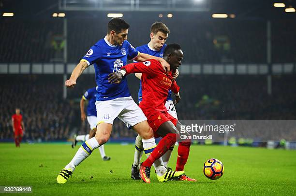 Sadio Mane of Liverpool battles with Gareth Barry and Seamus Coleman of Everton during the Premier League match between Everton and Liverpool at...