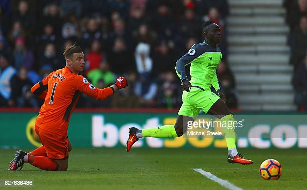 Sadio Mane of Liverpool beats Artur Boruc of AFC Bournemouth to score their first goal during the Premier League match between AFC Bournemouth and...