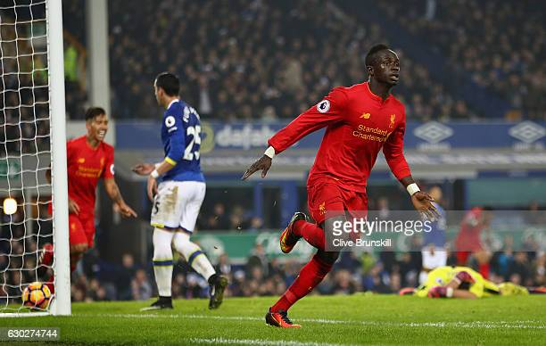 Sadio Mane of Liverpool celebrates after scoring the winning goal in injury time during the Premier League match between Everton and Liverpool at...