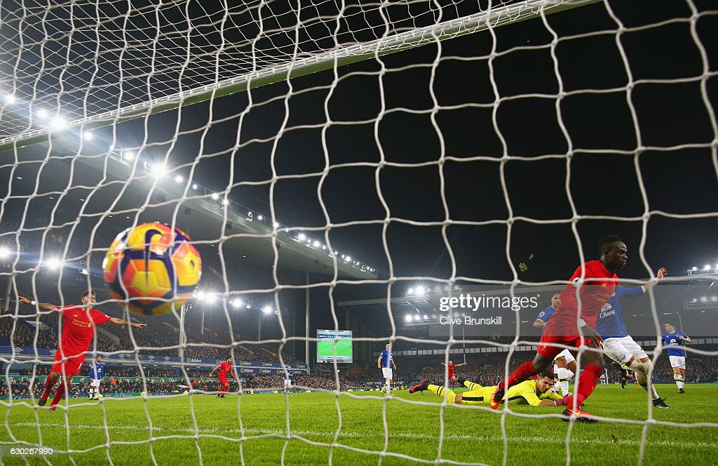 Sadio Mane of Liverpool (R) celebrates as he scores their first goal during the Premier League match between Everton and Liverpool at Goodison Park on December 19, 2016 in Liverpool, England.