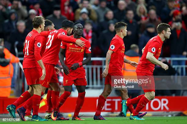 Sadio Mane of Liverpool celebrates scoring his second and his sides fifth goal with team mates during the Premier League match between Liverpool and...