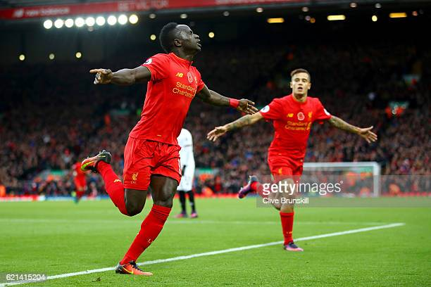 Sadio Mane of Liverpool celebrates scoring his sides first goal during the Premier League match between Liverpool and Watford at Anfield on November...