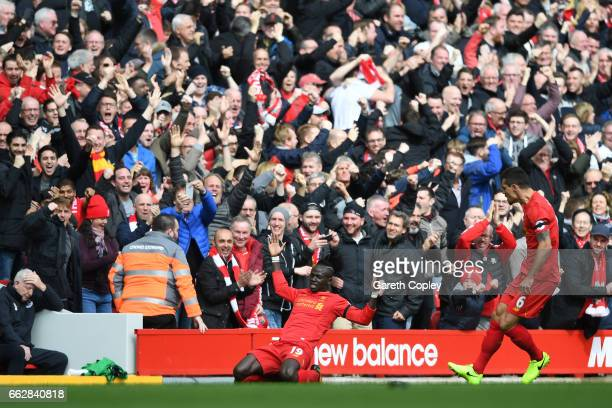 Sadio Mane of Liverpool celebrates scoring his sides first goal during the Premier League match between Liverpool and Everton at Anfield on April 1...