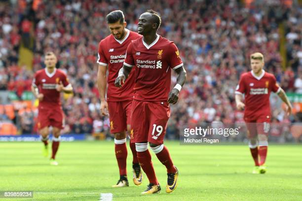 Sadio Mane of Liverpool celebrates scoring his sides second goal during the Premier League match between Liverpool and Arsenal at Anfield on August...