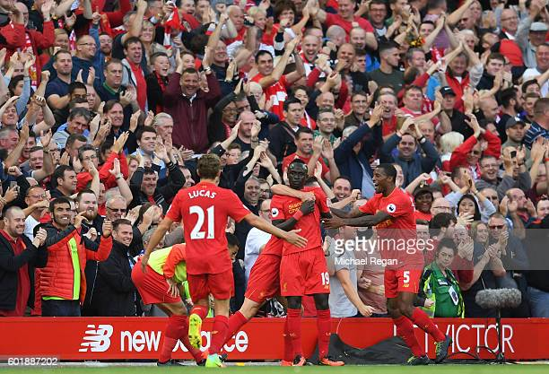 Sadio Mane of Liverpool celebrates scoring his sides second goal with team mates during the Premier League match between Liverpool and Leicester City...