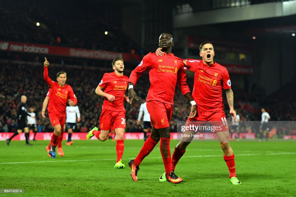 Sadio Mane (2nd R) of Liverpool celebrates scoring his side's second goal with his team mate Philippe Coutinho (1st R) during the Premier League match between Liverpool and Tottenham Hotspur at Anfield on February 11, 2017 in Liverpool, England.