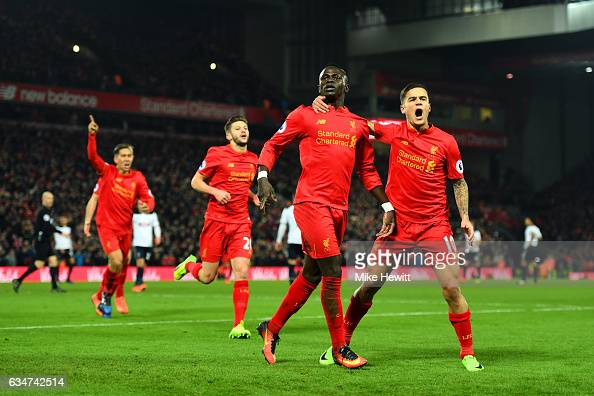 Sadio Mane of Liverpool celebrates scoring his side's second goal with his team mate Philippe Coutinho during the Premier League match between...