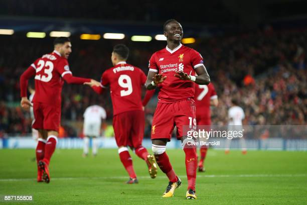 Sadio Mane of Liverpool celebrates scoring the 4th Liverpool goal with team mates during the UEFA Champions League group E match between Liverpool FC...