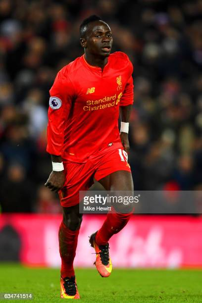 Sadio Mane of Liverpool celebrates scoring the opening goal during the Premier League match between Liverpool and Tottenham Hotspur at Anfield on...