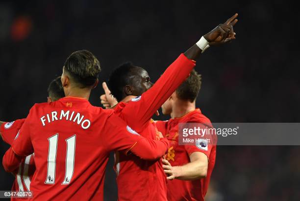 Sadio Mane of Liverpool celebrates scoring the opening goal with his team mates during the Premier League match between Liverpool and Tottenham...