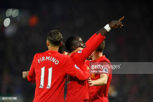 Sadio Mane of Liverpool celebrates scoring the oprning goal with his team mates during the Premier League match between Liverpool and Tottenham...