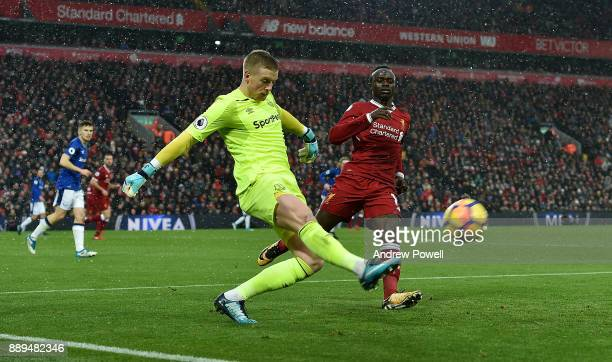 Sadio Mane of Liverpool closes down Jordan Pickford of Everton during the Premier League match between Liverpool and Everton at Anfield on December...