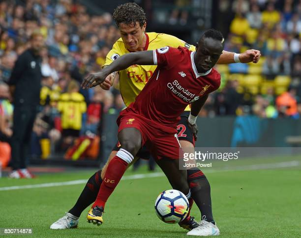 Sadio Mane of Liverpool competes with Daryl Janmaat of Watford during the Premier League match between Watford and Liverpool at Vicarage Road on...