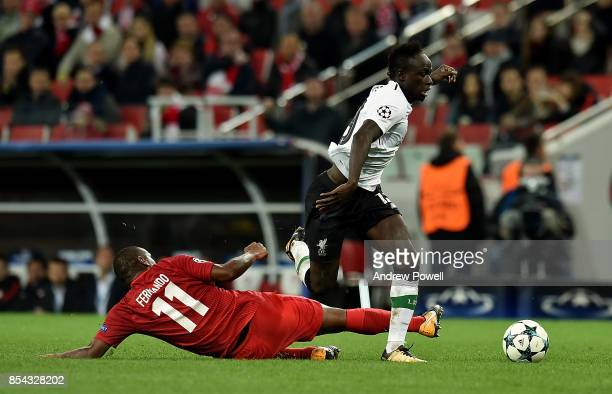 Sadio Mane of Liverpool competes with Fernando of Spartak Moskva during the UEFA Champions League group E match between Spartak Moskva and Liverpool...