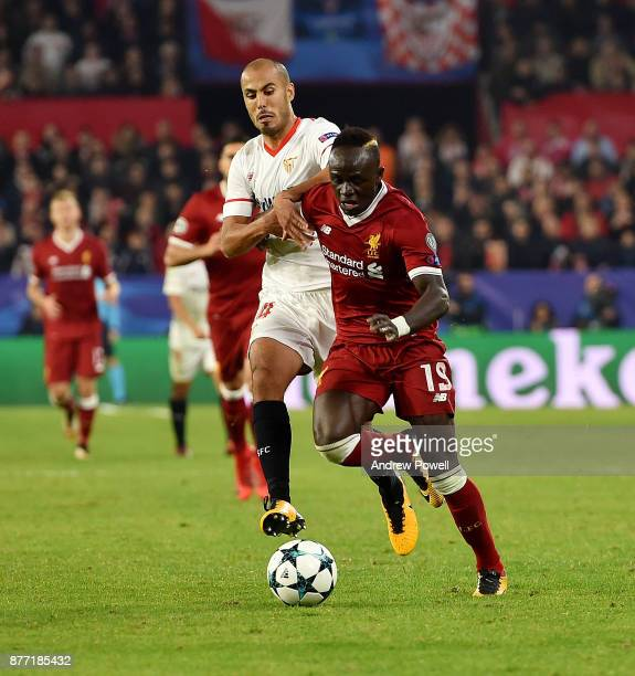 Sadio Mane of Liverpool competes with Guido Pizarro of Sevilla FC during the UEFA Champions League group E match between Sevilla FC and Liverpool FC...