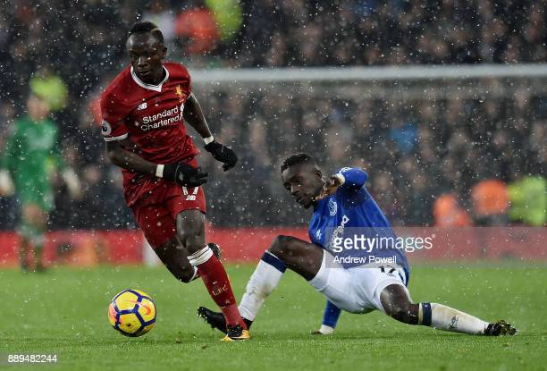 Sadio Mane of Liverpool competes with Idrissa Gana Gueye of Everton during the Premier League match between Liverpool and Everton at Anfield on...