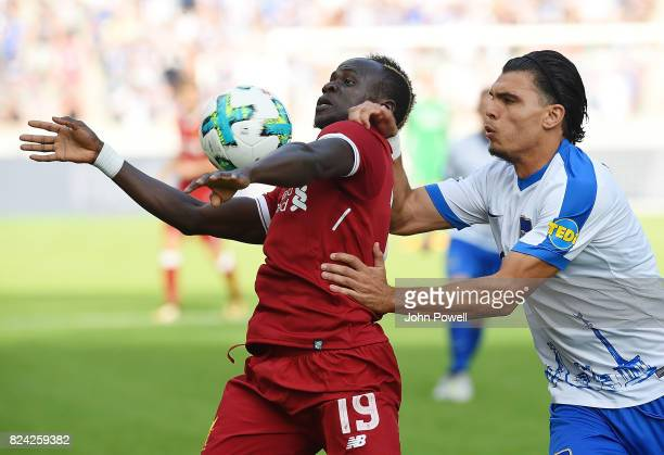 Sadio Mane of Liverpool competes with Karim Rekik of Hertha BSC during the preseason friendly match between Hertha BSC and FC Liverpool at...